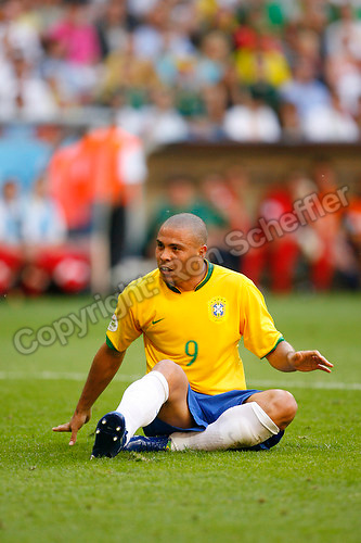 Jun 18, 2006; Munich, GERMANY; Brazil forward (9) Ronaldo sits on the pitch after missing a shot on goal during the first half of the  match against Australia in first round Group F action of the 2006 FIFA World Cup at FIFA World Cup Stadium Munich. Mandatory Credit: Ron Scheffler-US PRESSWIRE Copyright © Ron Scheffler.