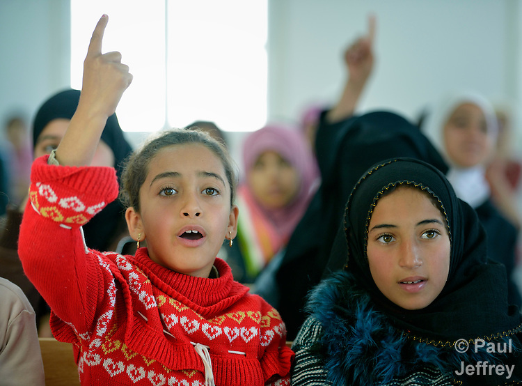 Girls in class in the Zaatari Refugee Camp, located near Mafraq, Jordan. Opened in July, 2012, the camp holds upwards of 50,000 refugees from the civil war inside Syria. International Orthodox Christian Charities and other members of the ACT Alliance are active in the camp providing essential items and services.