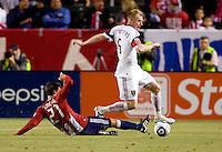 Real Salt Lake defender Nat Borchers (6) moves past Chivas USA midfielder Ben Zemanski (21). Real Salt Lake defeated CD Chivas USA 2-1at Home Depot Center stadium in Carson, California on Saturday May 22, 2010.  .