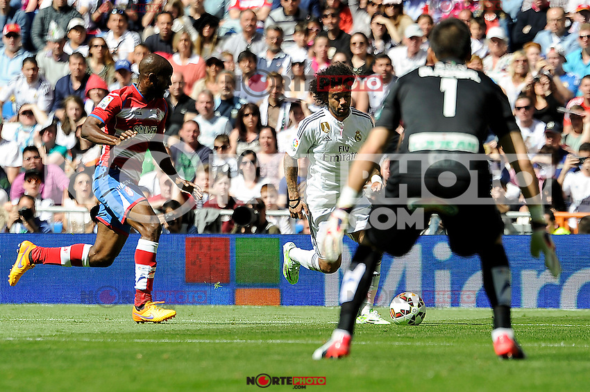Real Madrid´s Marcelo Vieira and Granada´s goalkeeper Oier Olazabal and Dimitri Foulquier during 2014-15 La Liga match between Real Madrid and Granada at Santiago Bernabeu stadium in Madrid, Spain. April 05, 2015. (ALTERPHOTOS/Luis Fernandez) /NORTEphoto.com