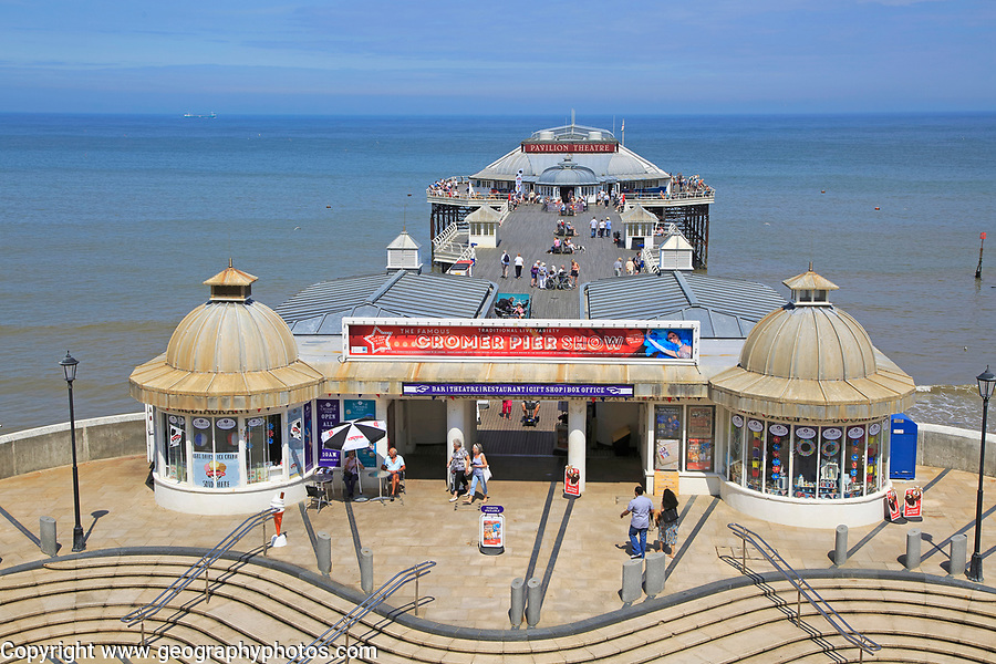 Sunny summer day sea beach and pier at  Cromer, Norfolk, England, UK
