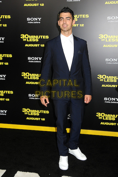 "Joe Jonas.""30 Minutes or Less"" World Premiere held at Grauman's Chinese Theatre, Hollywood, California, USA..August 8th, 2011.full length suit shirt  black white.CAP/ADM/BP.©Byron Purvis/AdMedia/Capital Pictures."