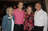 NWA Democrat-Gazette/CARIN SCHOPPMEYER Mary Zettle (from left), Brandon and Kari Nikolish and Mike Turner attend the Swing for the Cure pre-party.