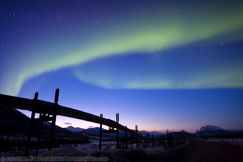Aurora borealis over the trans alaska pipeline in the Brooks range, arctic, Alaska.