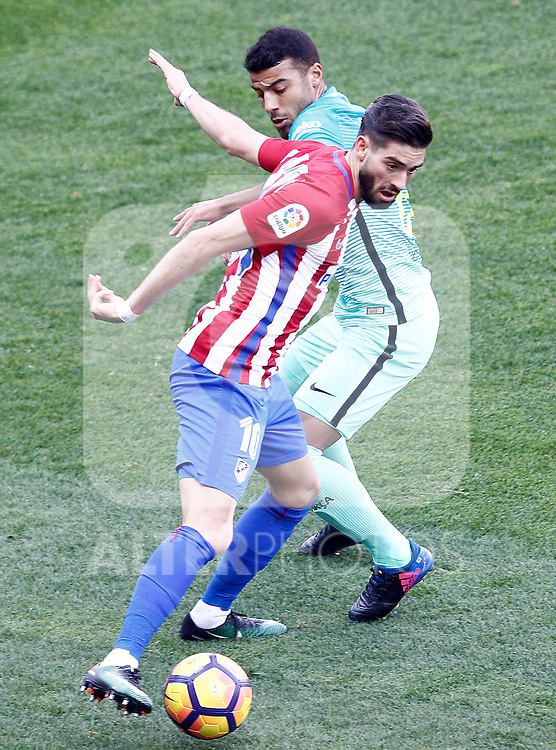 Atletico de Madrid's Yannick Ferreira Carrasco (l) and FC Barcelona's Rafinha Alcantara during La Liga match. February 26,2017. (ALTERPHOTOS/Acero)