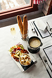 USA, Colorado, Aspen, table setting with cheese fondue and champagne at the Cloud Nine Restaurant, Aspen Highlands Ski Resort