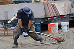 Chico Beach Cottages,  construction worker, cutting rebar, built green, cottage houses, Silverdale, Dyes Inlet, Cottage Company, Seattle, Washington, Pacific Northwest, USA,