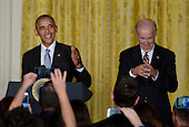 United States President Barack Obama (L) speaks as Vice President Joe Biden  looks on during a reception for Hispanic Heritage Month in the East Room of the White House on October 12, 2016 in Washington, DC. <br /> Credit: Olivier Douliery / Pool via CNP