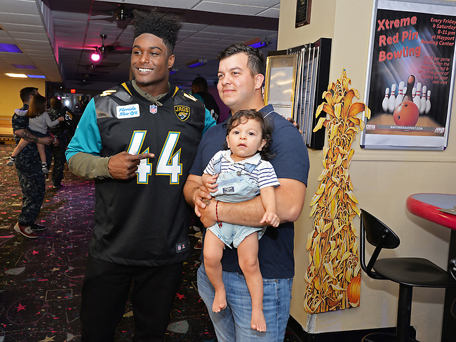 Jacksonville Jaguars player Myles Jack (44) poses for a photo as he visits with Navy personnel at Mayport Naval Station's bowling alley Monday, November 6, 2017 in Jacksonville, Fl.  (Rick Wilson/Jacksonville Jaguars)