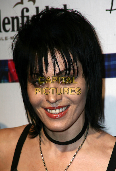 JOAN JETT .8th annual 'Dressed To Kilt' Charity Fashion Show presented by Glenfiddich at M2 Ultra Lounge New York City, NY, USA, 6th April 2010..portrait headshot  fringe make-up necklace choker black smiling .CAP/ADM/PZ.©Paul Zimmerman/Admedia/Capital Pictures