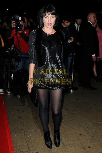 "SADIE FROST .Attending the ""Mr. Nice"" UK Film Premiere, Cineworld cinema, Haymarket, London, England, UK, October 4th 2010. .full length black shiny dress tights ankle boots tuxedo tux clutch bag jacket .CAP/CAS.©Bob Cass/Capital Pictures."