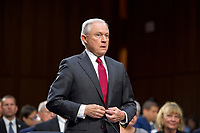 "United States Attorney General Jeff Sessions prepares to be sworn-in to testify before the US Senate Select Committee on Intelligence to  ""examine certain intelligence matters relating to the 2016 United States election"" on Capitol Hill in Washington, DC on Tuesday, June 13, 2017.  In his prepared statement Attorney General Sessions said it was an ""appalling and detestable lie"" to accuse him of colluding with the Russians. Photo Credit: Ron Sachs/CNP/AdMedia"