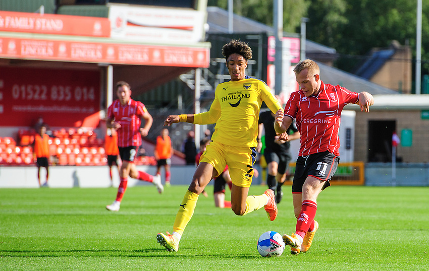 Lincoln City's Anthony Scully vies for possession with Oxford United's Sean Clare<br /> <br /> Photographer Chris Vaughan/CameraSport<br /> <br /> The EFL Sky Bet League One - Saturday 12th September 2020 - Lincoln City v Oxford United - LNER Stadium - Lincoln<br /> <br /> World Copyright © 2020 CameraSport. All rights reserved. 43 Linden Ave. Countesthorpe. Leicester. England. LE8 5PG - Tel: +44 (0) 116 277 4147 - admin@camerasport.com - www.camerasport.com - Lincoln City v Oxford United