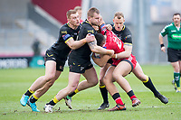 Picture by Allan McKenzie/SWpix.com - 07/04/2018 - Rugby League - Betfred Super League - Salford Red Devils v Warrington Wolves - AJ Bell Stadium, Salford, England - Warrington's Jack Hughes, Mike Cooper and Kevin brown tackle Salford's Derrell Olpherts.