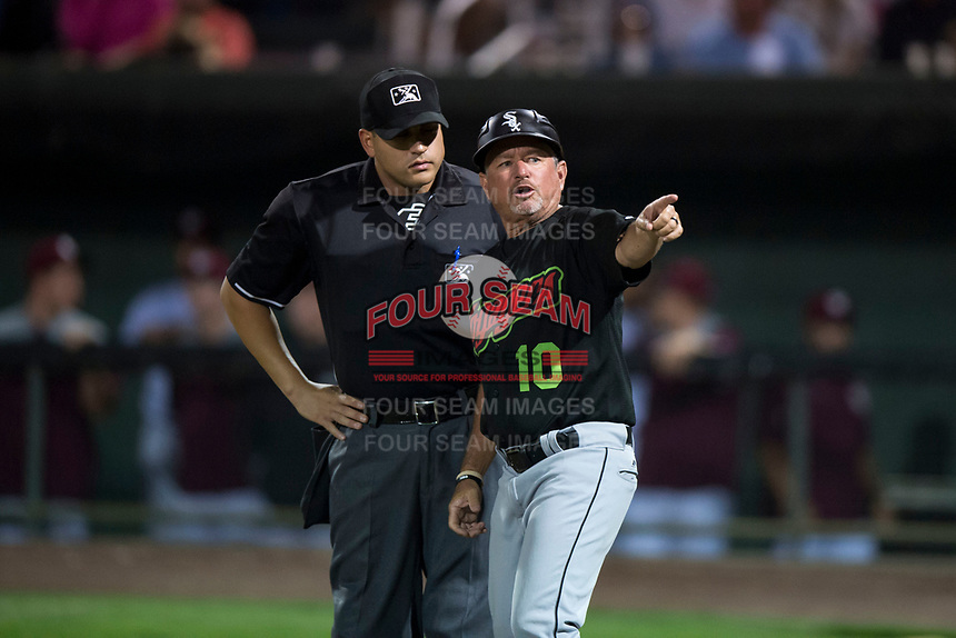 Great Falls Voyagers manager Tim Esmay (10) argues with home plate umpire Ethan McCranie during a Pioneer League game against the Idaho Falls Chukars at Melaleuca Field on August 18, 2018 in Idaho Falls, Idaho. The Idaho Falls Chukars defeated the Great Falls Voyagers by a score of 6-5. (Zachary Lucy/Four Seam Images)