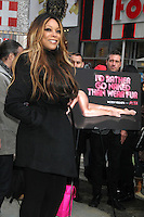 NEW YORK, NY - NOVEMBER 28: Wendy Williams unveils PETA's national winter campaign, 'Rather Go Naked Than Wear Fur' at Times Square in New York City. November 28, 2012. Credit: RW/MediaPunch Inc. /NortePhoto