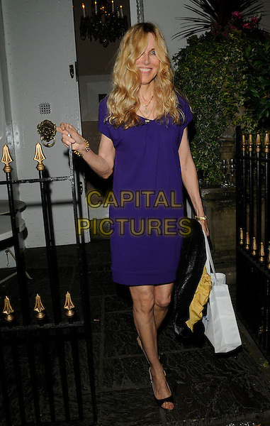 ALANA STEWART .At Kimberly Stewart's 30th birthday party,  Beach Blanket Babylon, Ledbury Road, London, England, UK, .August 20th 2009..full length purple blue dress black open toe shoes white tote bag mom mum mother .CAP/CAN.©Can Nguyen/Capital Pictures