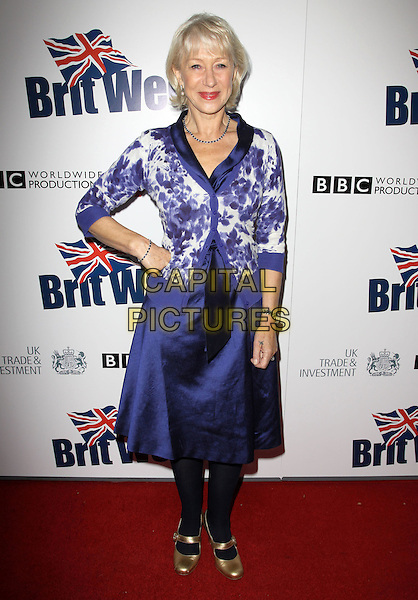 HELEN MIRREN.The BritWeek 2010 Champagne Launch held At The British General Consul Residence, Los Angeles, California, USA..April 20th, 2010.full length blue white silk satin skirt floral print cardigan top black tights gold mary janes shoes hand on hip.CAP/ADM/KB.©Kevan Brooks/AdMedia/Capital Pictures.