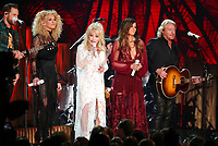 "Dolly Parton, center, Jimi Westbrook, from left, Kimberly Schlapman, Karen Fairchild, and Philip Sweet, of Little Big Town, perform ""Red Shoes"" at the 61st annual Grammy Awards on Sunday, Feb. 10, 2019, in Los Angeles. (Photo by Matt Sayles/Invision/AP)"