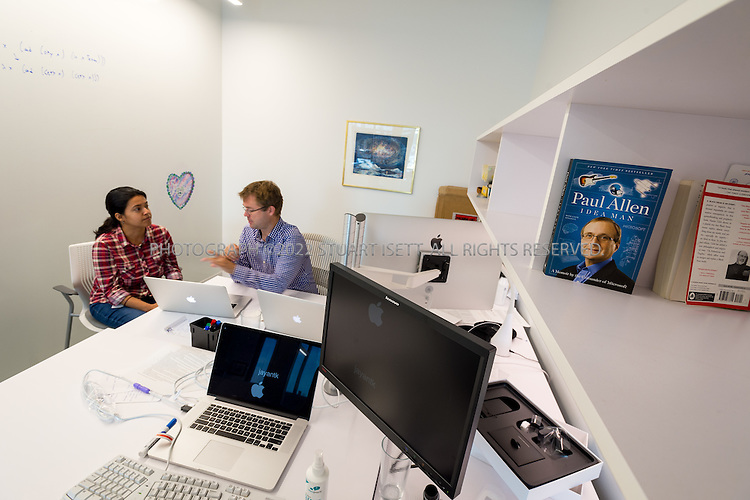 SEATTLE, USA - SEPTEMBER 16th, 2015<br /> <br /> Oyvind Tafjord (right) a Senior Software Architect, meets with Bhavana Dalvi (left), a Research Scientist, in his office at the Allen Institute for Artificial Intelligence in Seattle, WA, USA. On the right sits Paul Allen&rsquo;s book &ldquo;Idea Man&rdquo;.<br /> <br /> The Allen Institute for Artificial Intelligence (abbreviated AI2) is a research institute funded by Microsoft co-founder Paul Allen to achieve scientific breakthroughs by constructing AI systems with reasoning, learning and reading capabilities. Oren Etzioni was appointed by Paul Allen in September 2013 to direct the research at the institute.<br /> <br /> (Photo by Stuart Isett for The Washington Post)