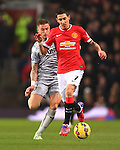 Michael Kightly of Burnley trips Angel di Maria of Manchester United to earn a yellow card - Manchester United vs. Burnley - Barclay's Premier League - Old Trafford - Manchester - 11/02/2015 Pic Philip Oldham/Sportimage
