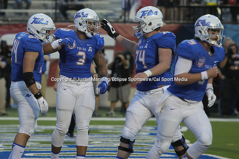 December 26, 2015: Tulsa RB Zach Langer celebrating with TE Mandel Dixon Jr. and center Chandler Miller after scoring a 1st quarter toachdown in the Camping World Independence Bowl at Independence Stadium in Shreveport, LA. Justin Manning/ESW/CSM