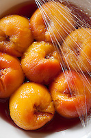 Detail of a bowl of peaches in syrup