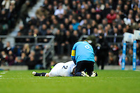 Dylan Hartley of England goes down after tackling Richie McCaw of New Zealand (not pictured) during the QBE Autumn International match between England and New Zealand at Twickenham on Saturday 16th November 2013 (Photo by Rob Munro)