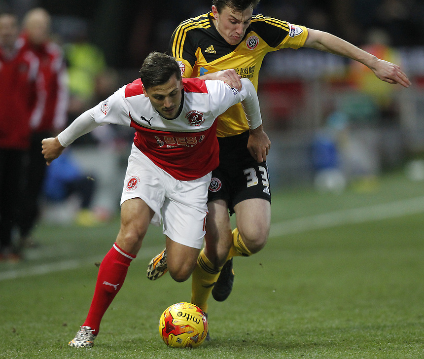Fleetwood Town's Antoni Sarcevic battles with  Sheffield United's Kieran Wallace<br /> <br /> Photographer Mick Walker/CameraSport<br /> <br /> Football - The Football League Sky Bet League One - Fleetwood Town v Sheffield United - Saturday 13th December 2014 - Highbury Stadium - Fleetwood<br /> <br /> &copy; CameraSport - 43 Linden Ave. Countesthorpe. Leicester. England. LE8 5PG - Tel: +44 (0) 116 277 4147 - admin@camerasport.com - www.camerasport.com