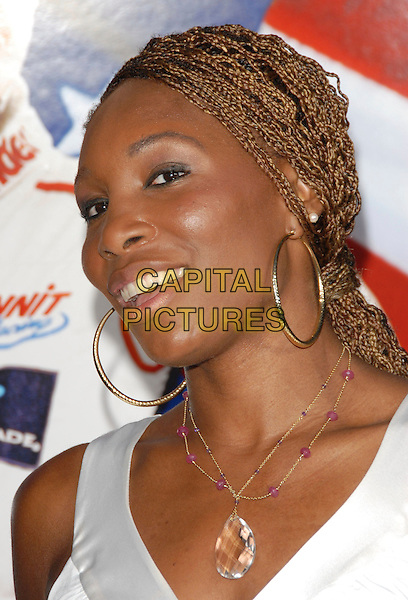 "VENUS WILLIAMS.World Premiere of ""Talladega Nights:The Ballad of Ricky Bobby"" held at The Grauman's Chinese Theatre in Hollywood, California, USA..July 26th, 2006.Ref: DVS.headshot portrait gold hoop earrings braids plaits crystal necklace.www.capitalpictures.com.sales@capitalpictures.com.©Debbie VanStory/Capital Pictures"