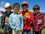 Four boys pose near a church in San Nicolas, Western Highlands, Guatemala