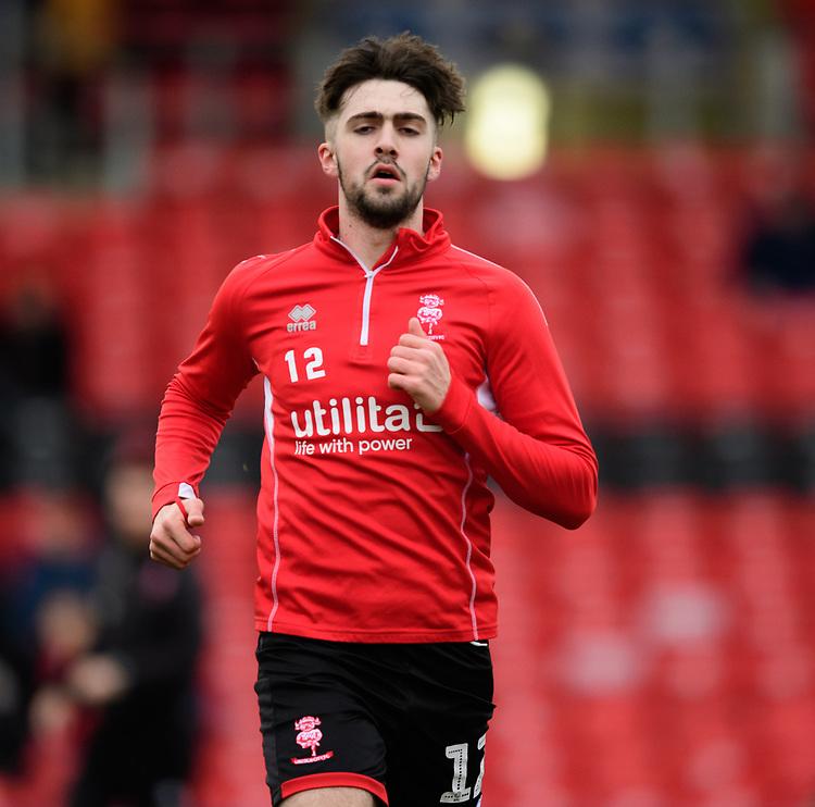 Lincoln City's Ellis Chapman during the pre-match warm-up<br /> <br /> Photographer Chris Vaughan/CameraSport<br /> <br /> The EFL Sky Bet League Two - Lincoln City v Newport County - Saturday 22nd December 201 - Sincil Bank - Lincoln<br /> <br /> World Copyright © 2018 CameraSport. All rights reserved. 43 Linden Ave. Countesthorpe. Leicester. England. LE8 5PG - Tel: +44 (0) 116 277 4147 - admin@camerasport.com - www.camerasport.com