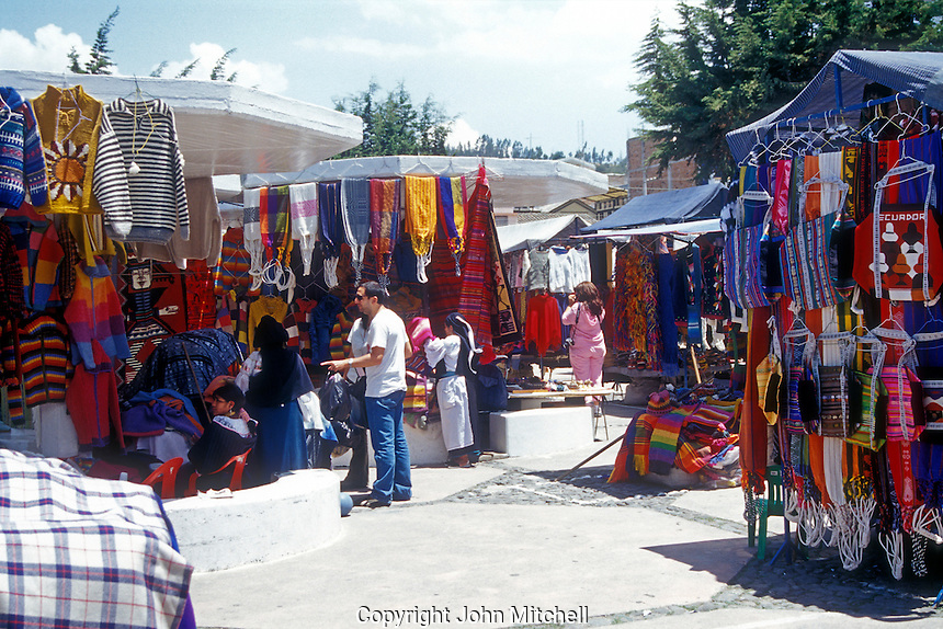 Tourists shopping at the handicrafts market in Poncho Plaza, Otavalo, Ecuador