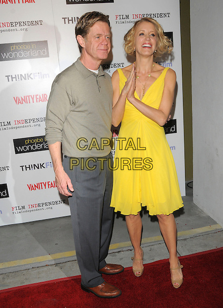 "WILLIAM H. MACY & FELICITY HUFFMAN .Screening of ""Phoebe in Wonderland"" held at The WGA in Beverly Hills, California, USA, .March 1st 2009.                                                                     .full length bright yellow dress beige open toe mary jane shoes patent husband wife grey gray shirt top trousers brown shoes .CAP/DVS.©RockinExposures/Capital Pictures"