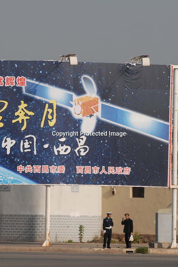 An advert fo the launch of the Long March Rocket in Xichang county in Sichuan, China. The Chinese made Long March Rocket called Chang'e 1, was launched near Quaianjin village, Sichuan Province, China.