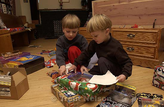 Noah Nelson and Nathaniel Nelson opening presents on Christmas. 12.25.2001, 8:04:32 AM<br />