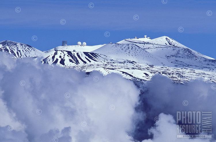 Snowcapped Mauna Kea volcano and scientific observatories. Big Island.