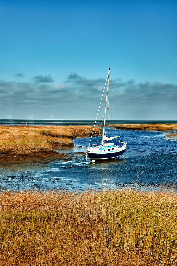 Sailboat anchored in salt marsh, Wharf Lane, Yarmouthport, Cape Cod, MA, Massachusetts