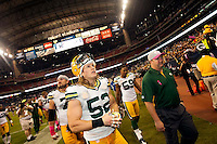 Green Bay Packers fans and Houston Texans fans reach out to Clay Matthews as he leaves the field after the Pack defeated the Texans 42-24 on Oct. 14, 2012.