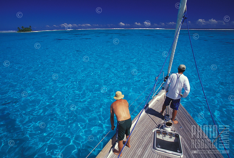 Setting anchor on the sailing yacht 'Heron' in crystal clear waters of Raiatea's lagoon, French Polynesia