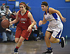 Allie Ponzio #12 of St. John the Baptist, left, moves the ball downcourt during a non-league girls basketball game against North Babylon at Robert Moses Middle School in North Babylon on Saturday, Dec. 22, 2018. North Babylon won by a score of 71-61.