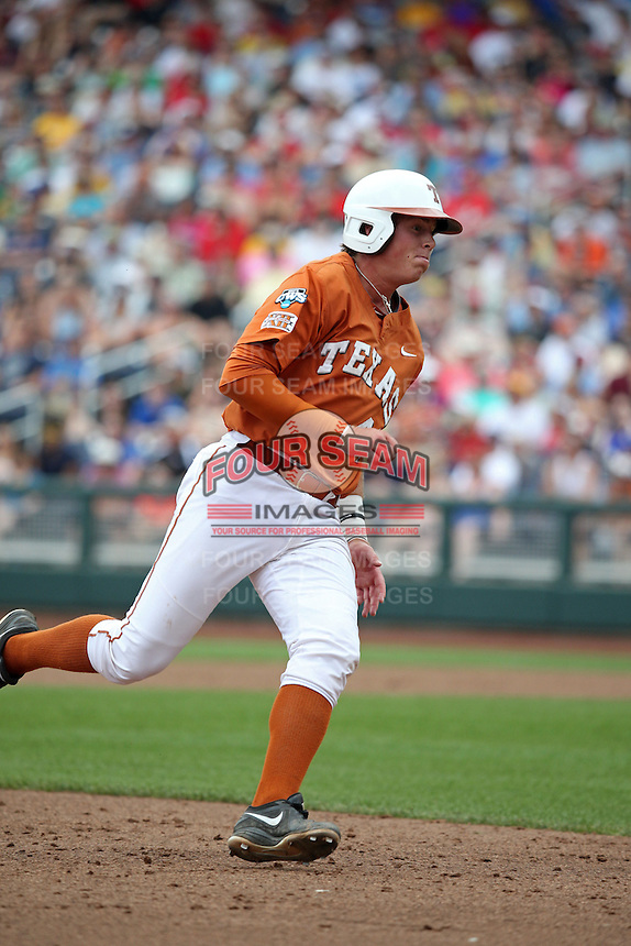 Kacy Clemens #42 of the Texas Longhorns runs during Game 1 of the 2014 Men's College World Series between the UC Irvine Anteaters and Texas Longhorns at TD Ameritrade Park on June 14, 2014 in Omaha, Nebraska. (Brace Hemmelgarn/Four Seam Images)