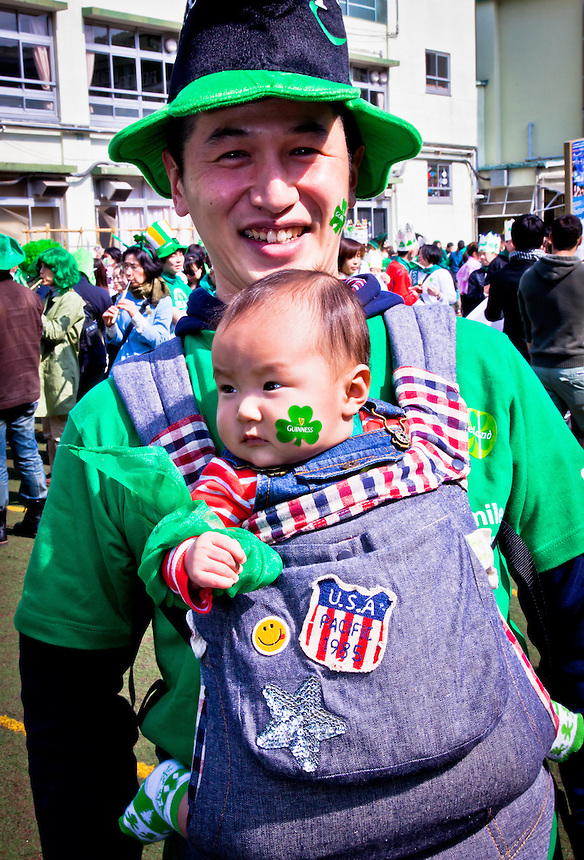 A father & baby dressed in green for Tokyo`s St.Patrick`s day parade.