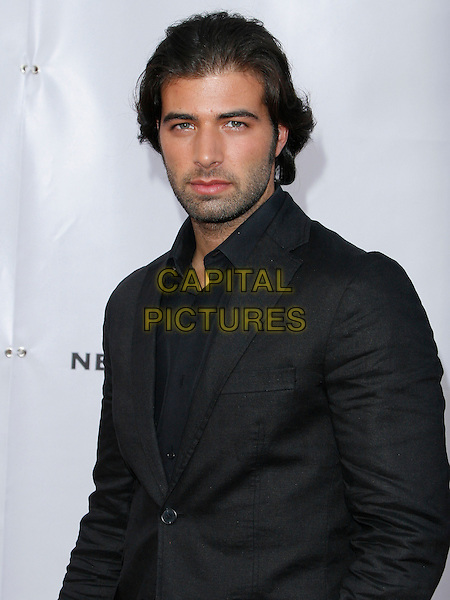 JENCARLOS CANELA . arriving at the The Cable Show 2010 To Feature An Evening With NBC Universal held at  Universal Studios Hollywood in Universal City, California, USA, .May 12th, 2010..half length black grey gray suit shirt beard facial hair stubble  .CAP/ROT/AMB.©Adriana M. Barraza /Roth Stock/Capital Pictures