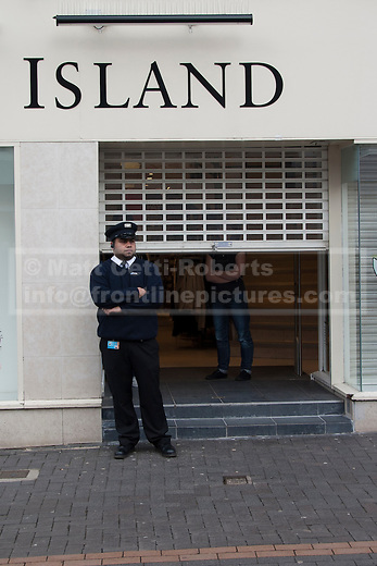 Shops raise their security as a deserted Dudley town centre prepares for the EDL to arrive.