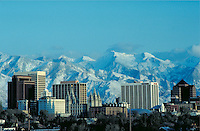 Downtown Salt Lake City, Utah and snowcovered Wasatch Mountains in the background. cityscape, urban design, skyline, geography. Salt Lake City Utah.