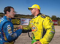 Oct 16, 2016; Ennis, TX, USA; NHRA funny car driver Matt Hagan (right) with Ron Capps during the Fall Nationals at Texas Motorplex. Mandatory Credit: Mark J. Rebilas-USA TODAY Sports