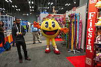 A Pac-Man character from Bandai toys wanders the halls at the 110th American International Toy Fair in the Jacob Javits Convention center in New York on Monday, February 11, 2013.  The four day trade show connects buyers and sellers and is expected to draw tens of thousands of attendees.  The toy industry generates  $21.87 billion in the United States and Toy Fair is the largest toy trade show in the Western Hemisphere. (© Richard B. Levine)