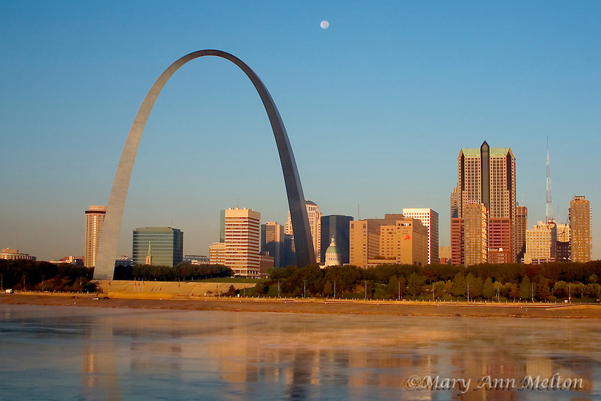 View of St. Louis, the Gateway Arch,  and the Mississippi River in the early morning.