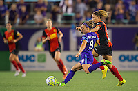 Orlando, Florida - Sunday, May 14, 2016: Orlando Pride forward Josee Belanger (9) plays a ball while Western New York Flash forward Lynn Williams (9) pressures during a National Women's Soccer League match between Orlando Pride and New York Flash at Camping World Stadium.
